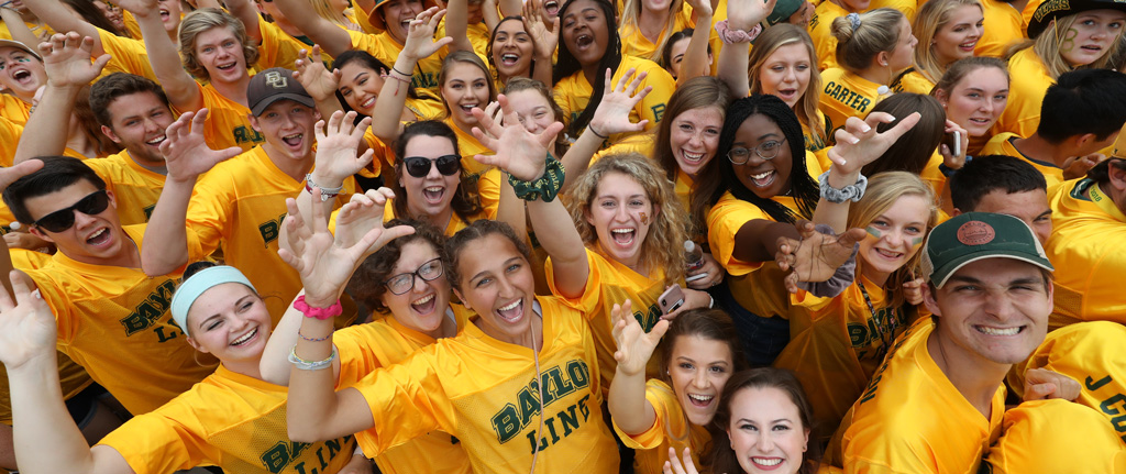 The Baylor Line, clad in gold jerseys, gets the energy going