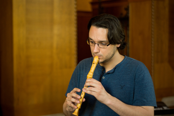 A School of Music student practices with a wind instrument
