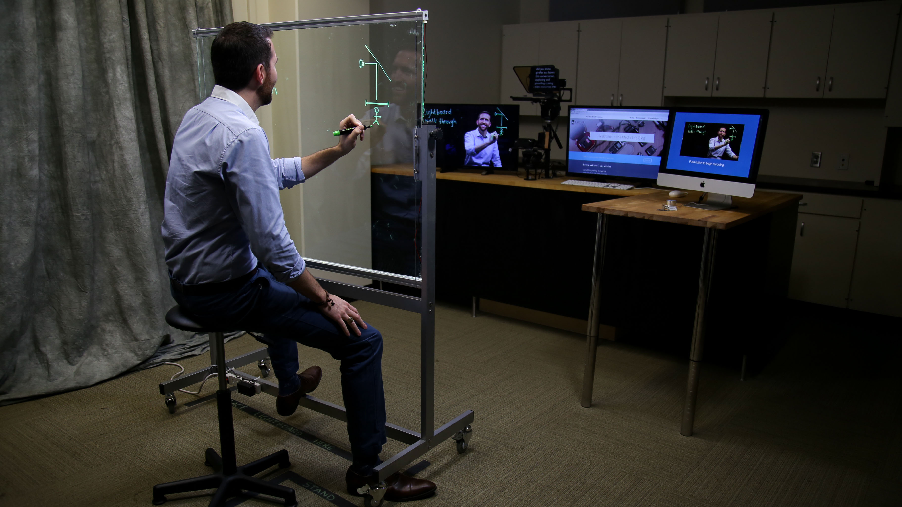 Photo of a professor using the Media Lab