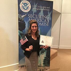 Full-length photo of Andromeda Vega Rubio holding an American Flag