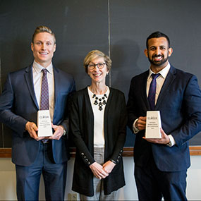 The winners pictured next to Law Professor Beth Miller