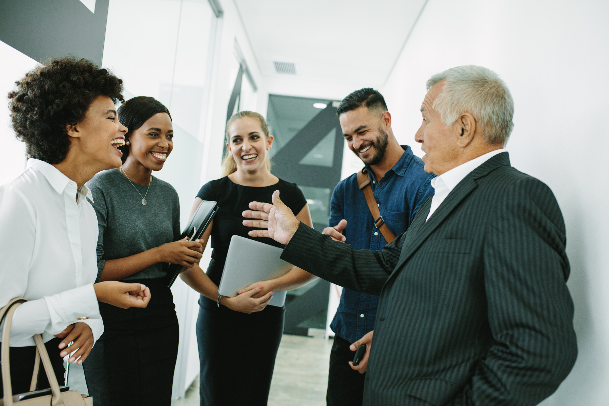 Stock photo of colleagues laughing in a hallway