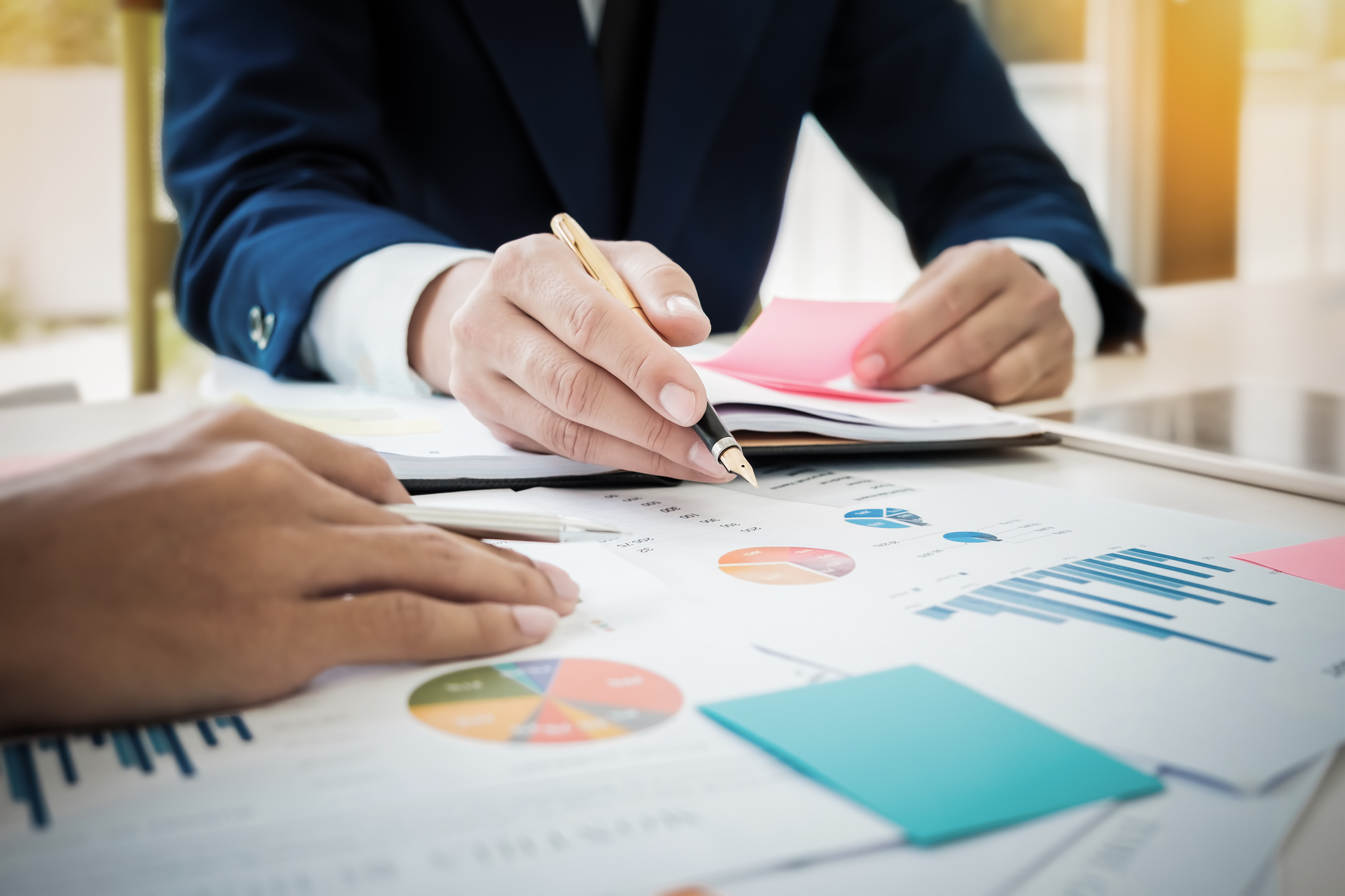 Stock photo of business graphs on paper