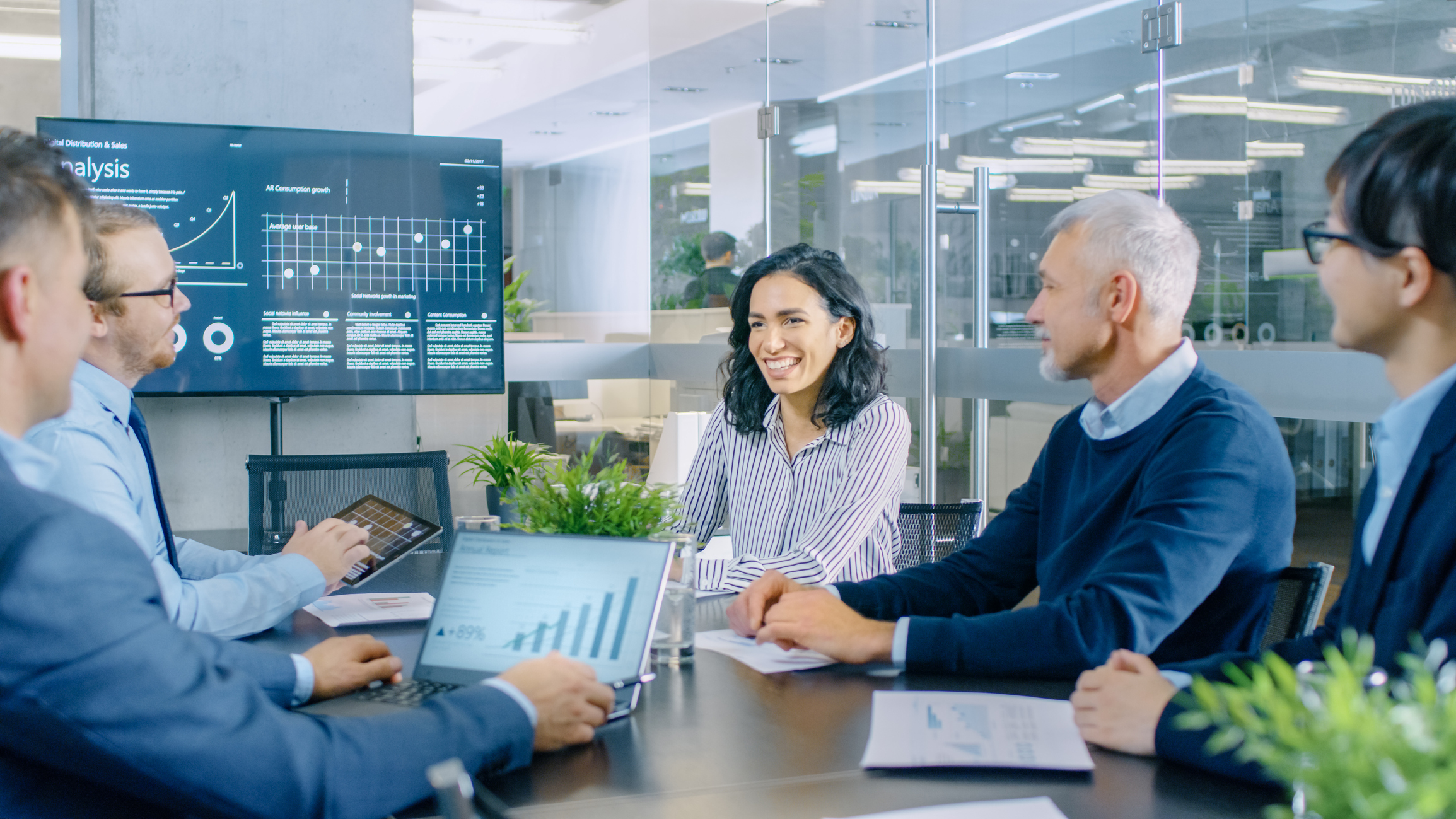 Stock Photo of business meeting with charts and graphs on display