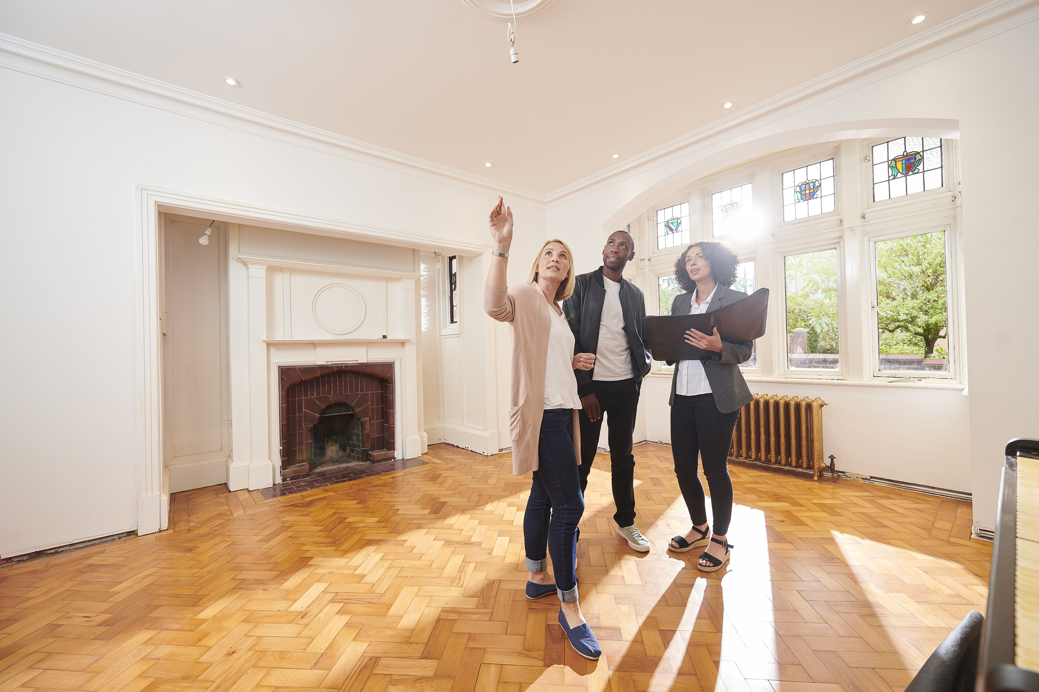 Stock photo of a couple touring a house with their relator