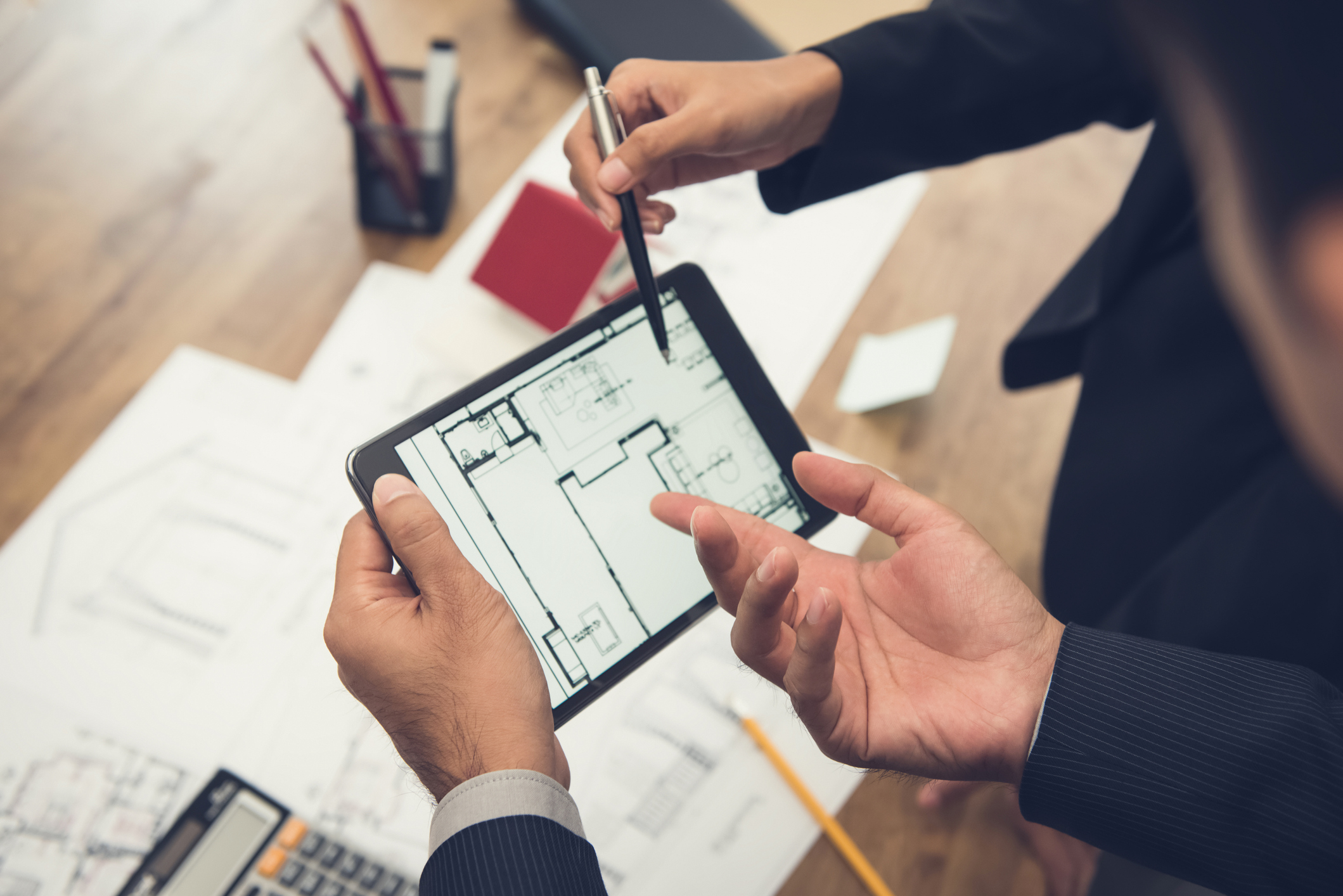 Stock photo of iPad with blueprints on the screen