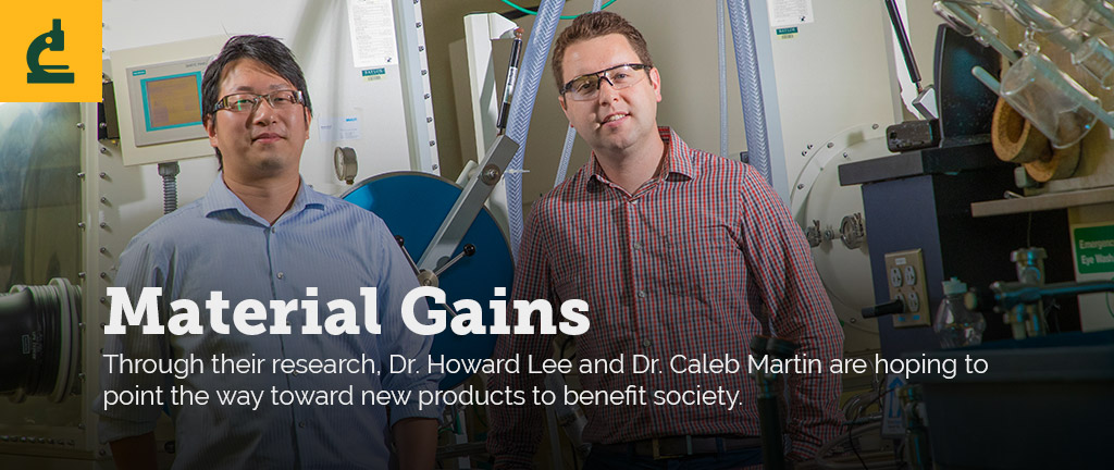 Dr. Howard Lee and Dr. Caleb Martin stand side-by-side in their lab