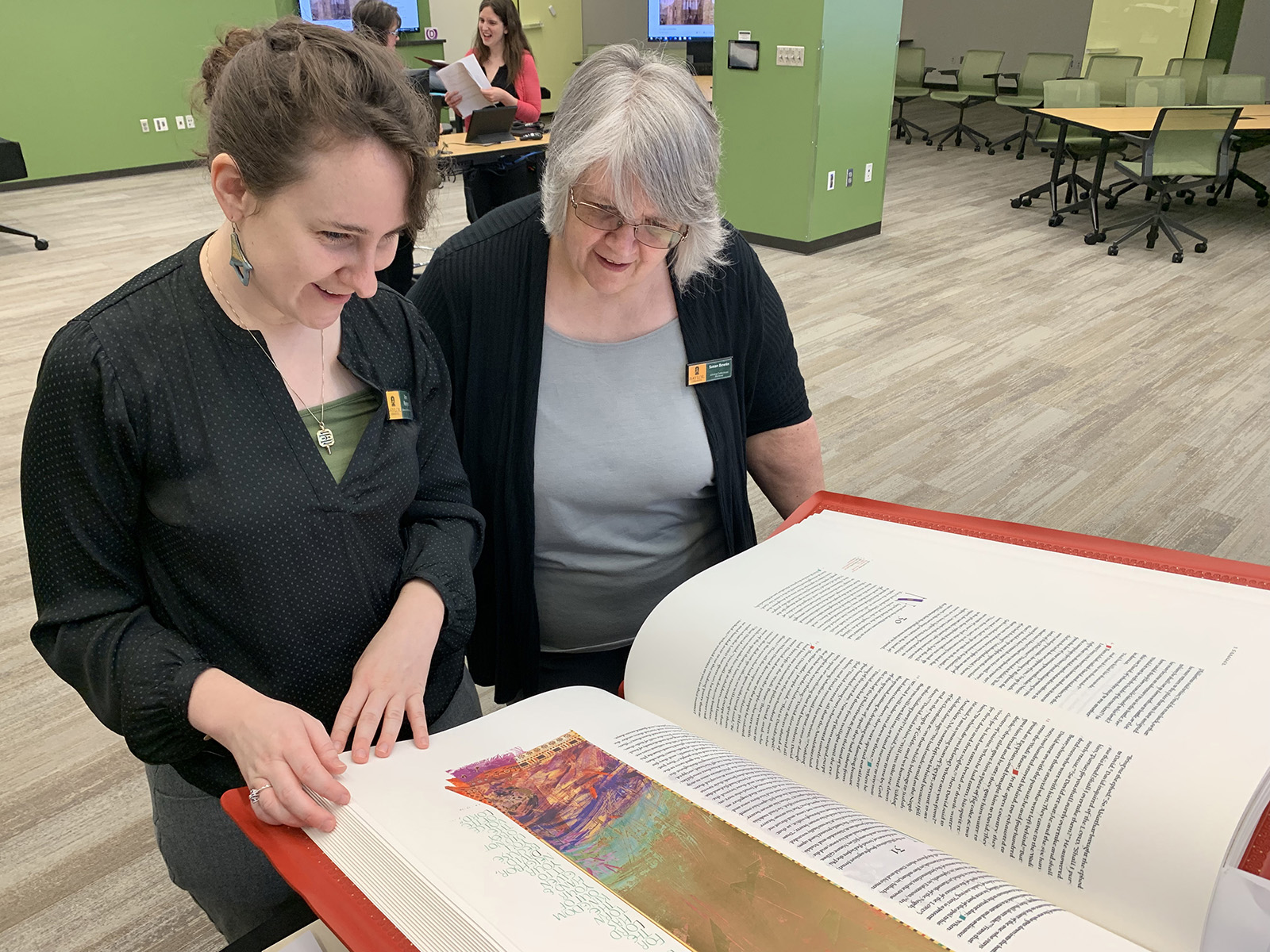 Amy Runyon and Susan Bowlin examine a volume from the St. John's Bible