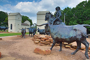 Waco Suspension Bridge and cattle drive statues