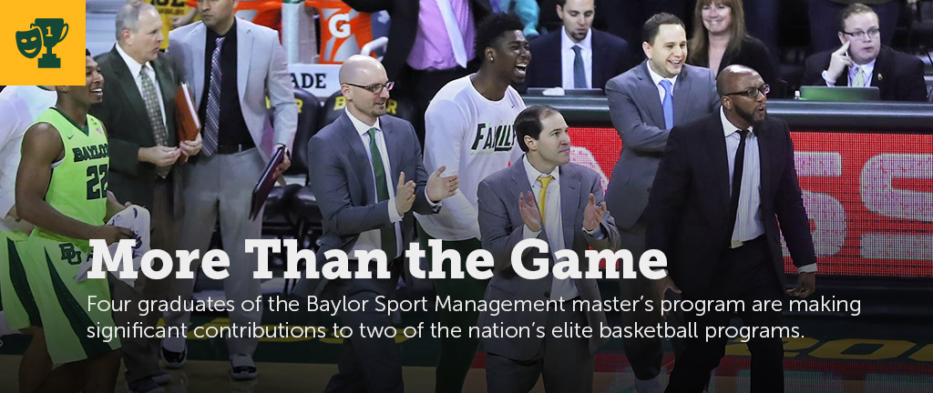 Coach Scott Drew and sports management program graduates come onto the Ferrell Center floor to celebrate during a men's basketball game.