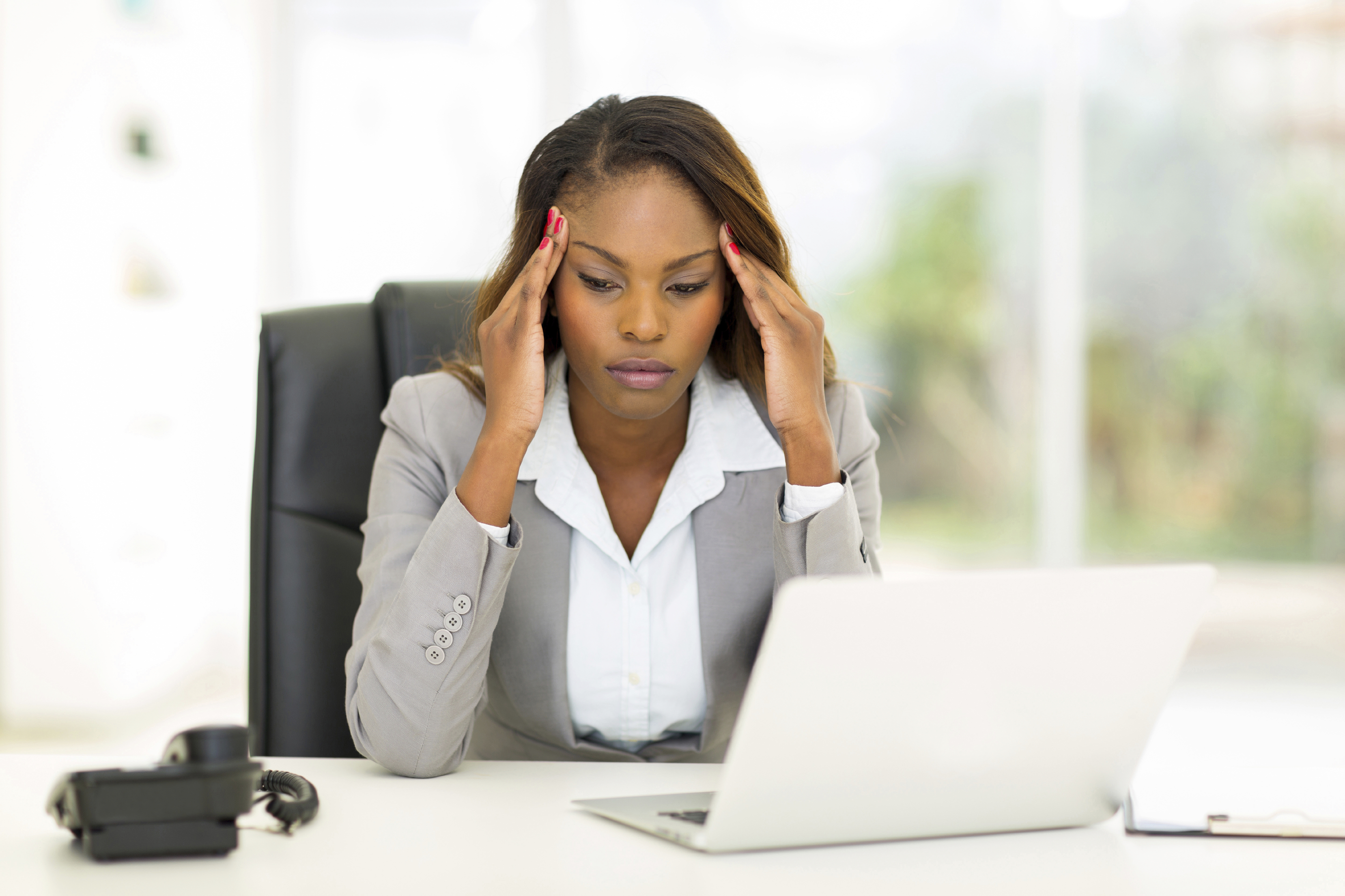 Stock Photo of a businesswoman dealing with stress