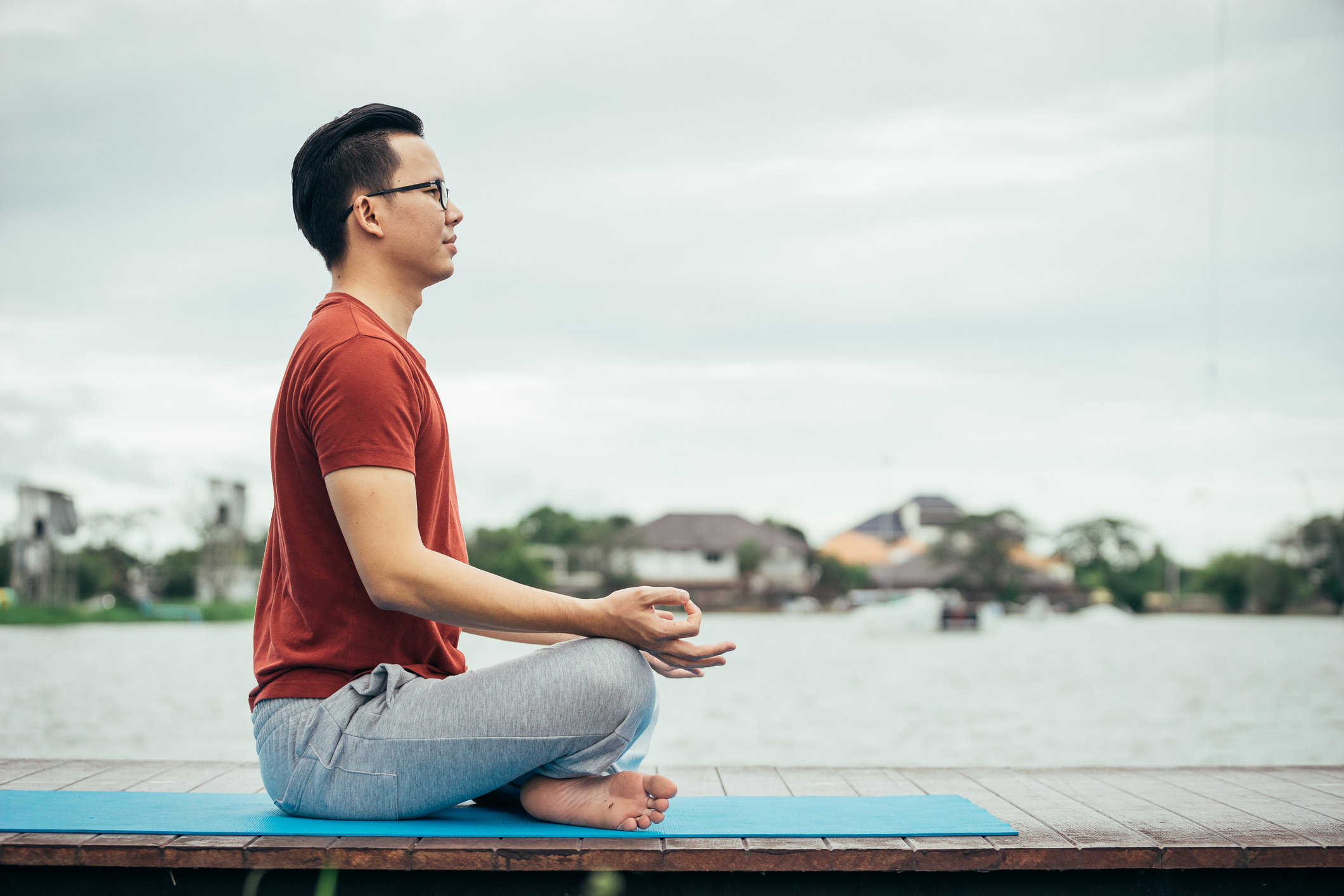 Stock photo of a man doing a meditative yoga pose