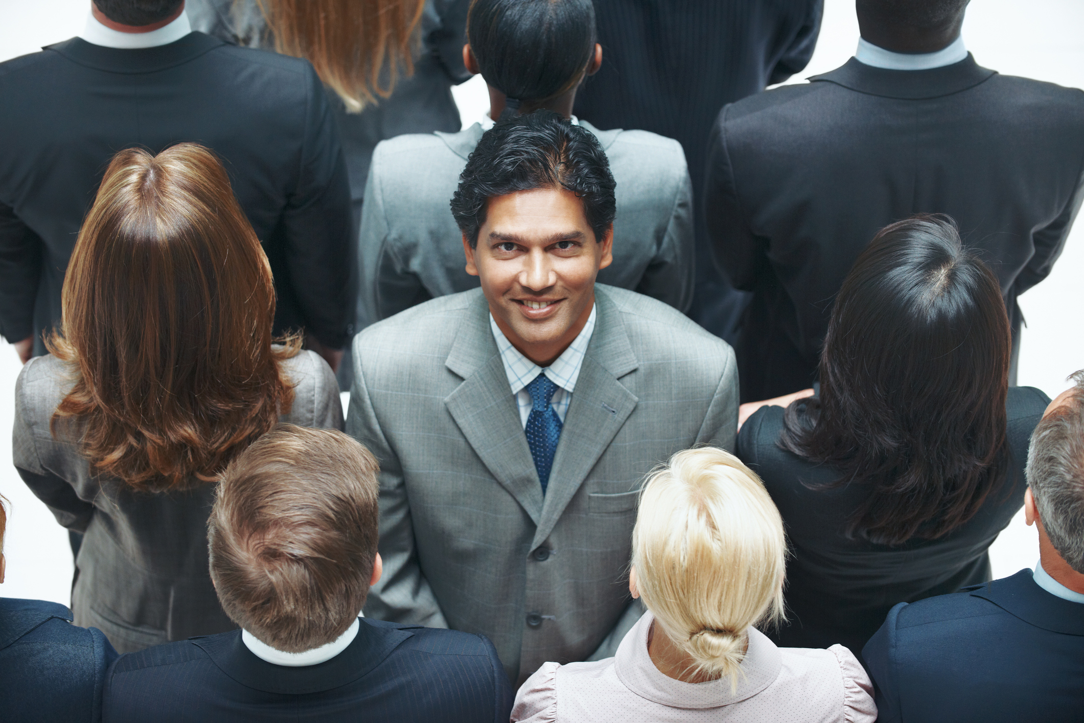 Stock Photo of a businessman against the stream of other businesspeople