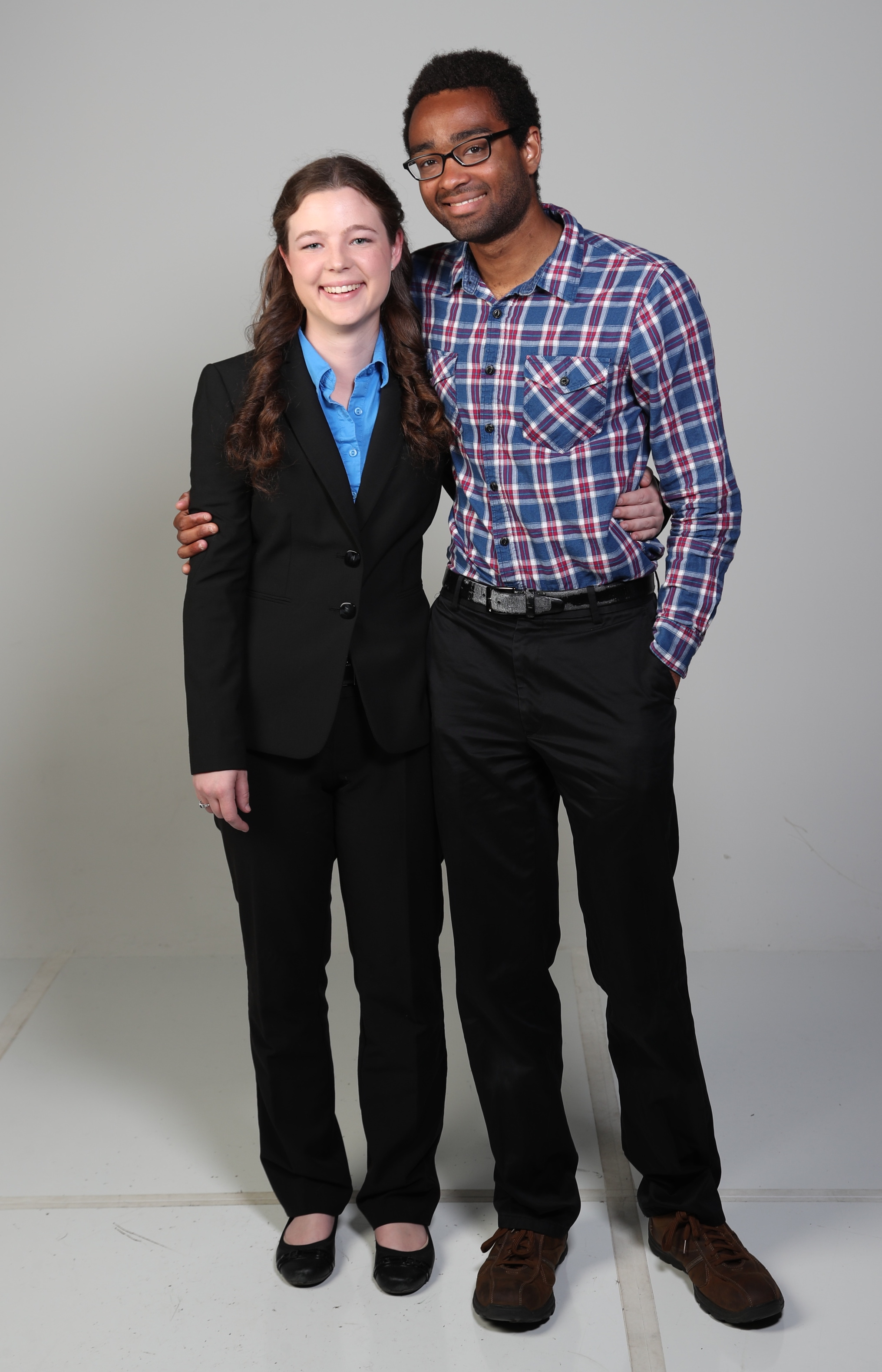 Full length picture of Catherine Arndt and Garrtt Williams in a studio