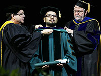 Hooding at August 2018 graduation ceremony