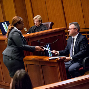 Tatiana Terry, eventual winner of Top Gun X, speaks in a courtroom