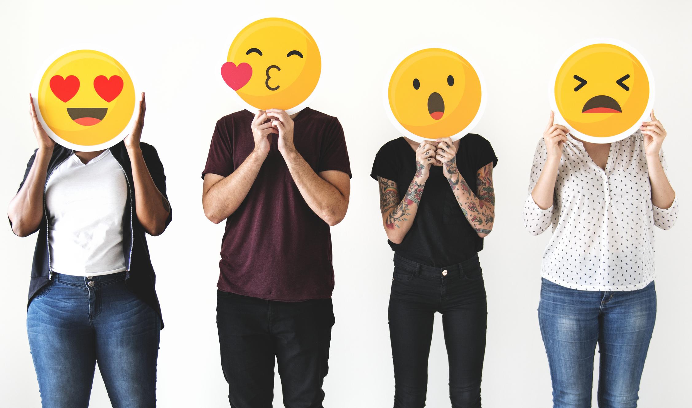 stock graphic of audience members as emojis