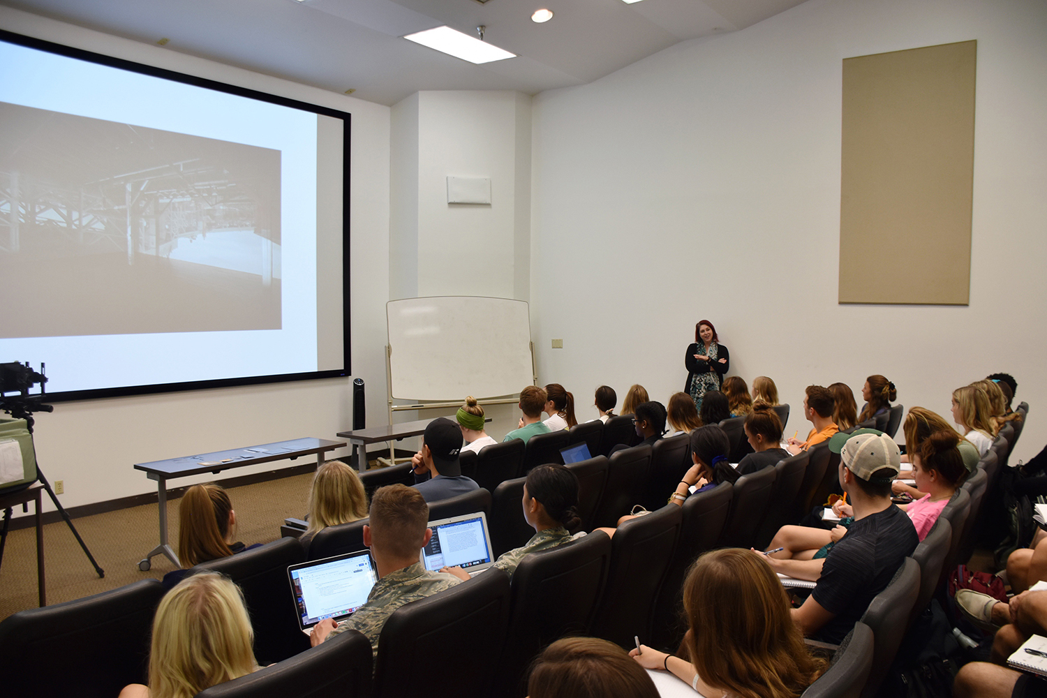 Professor Heather White teaching first year students how to understand and appreciate the art of photography.