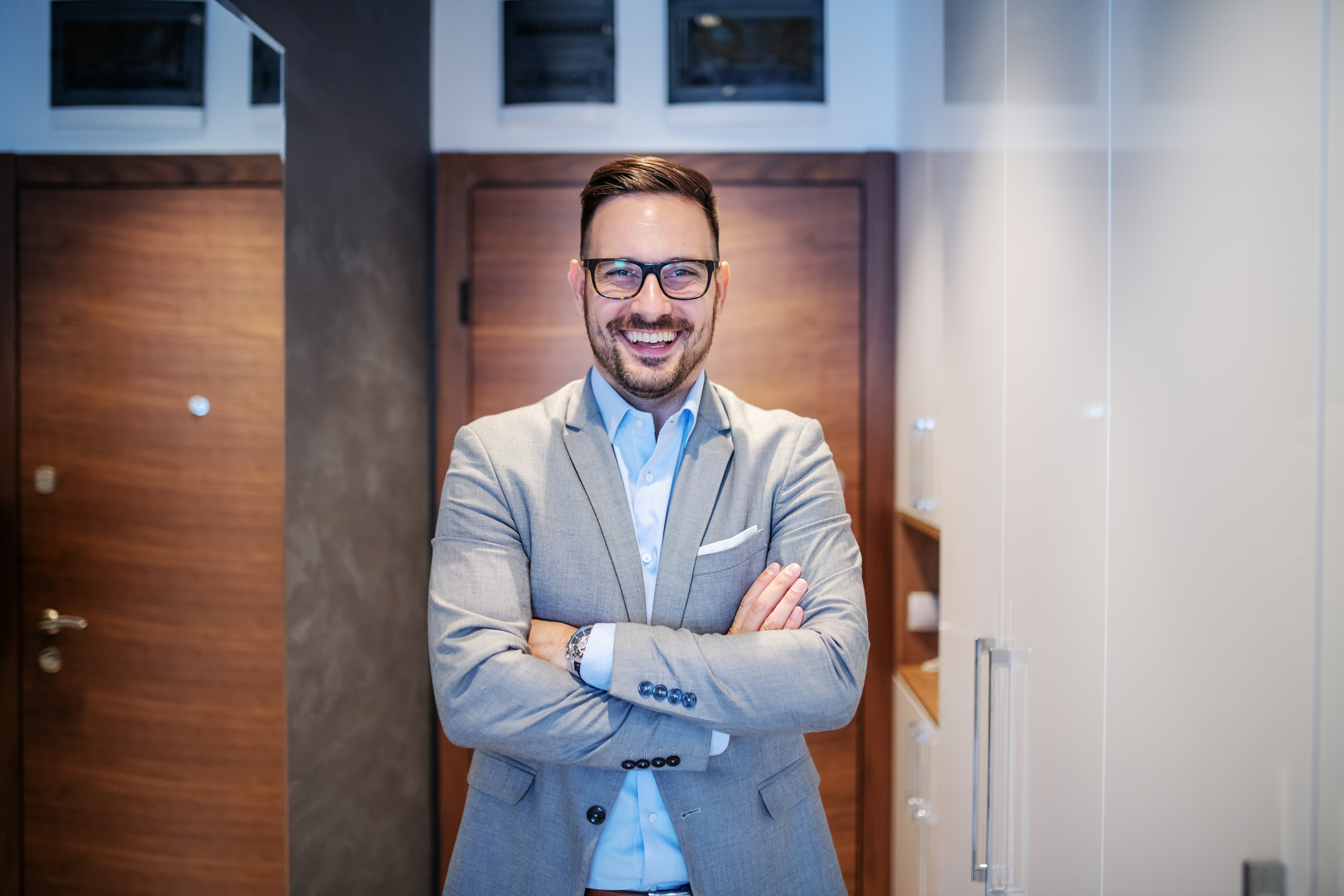 Stock photo of man in business suit, smiling