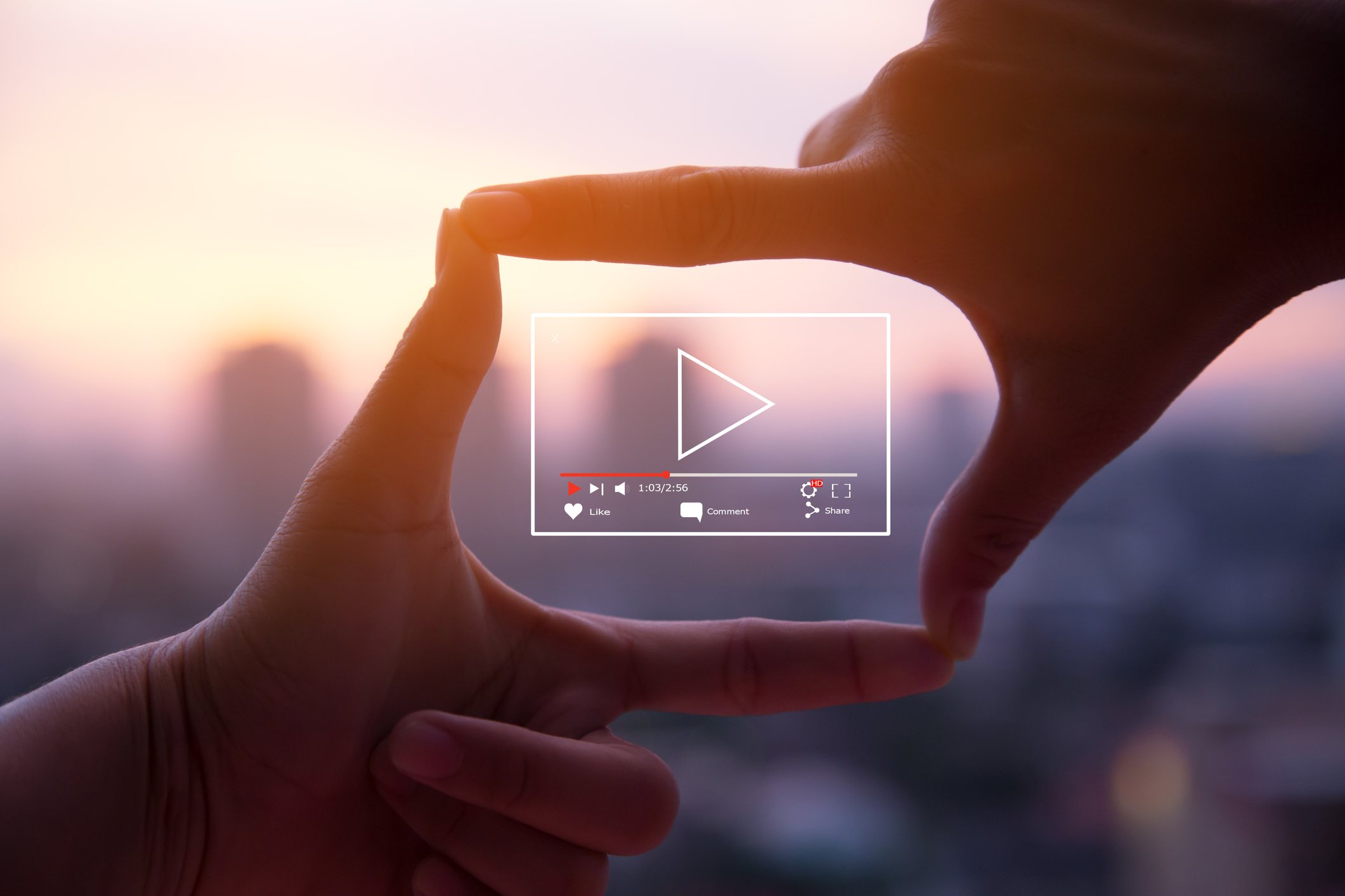stylized photo of hands framing a youtube frame