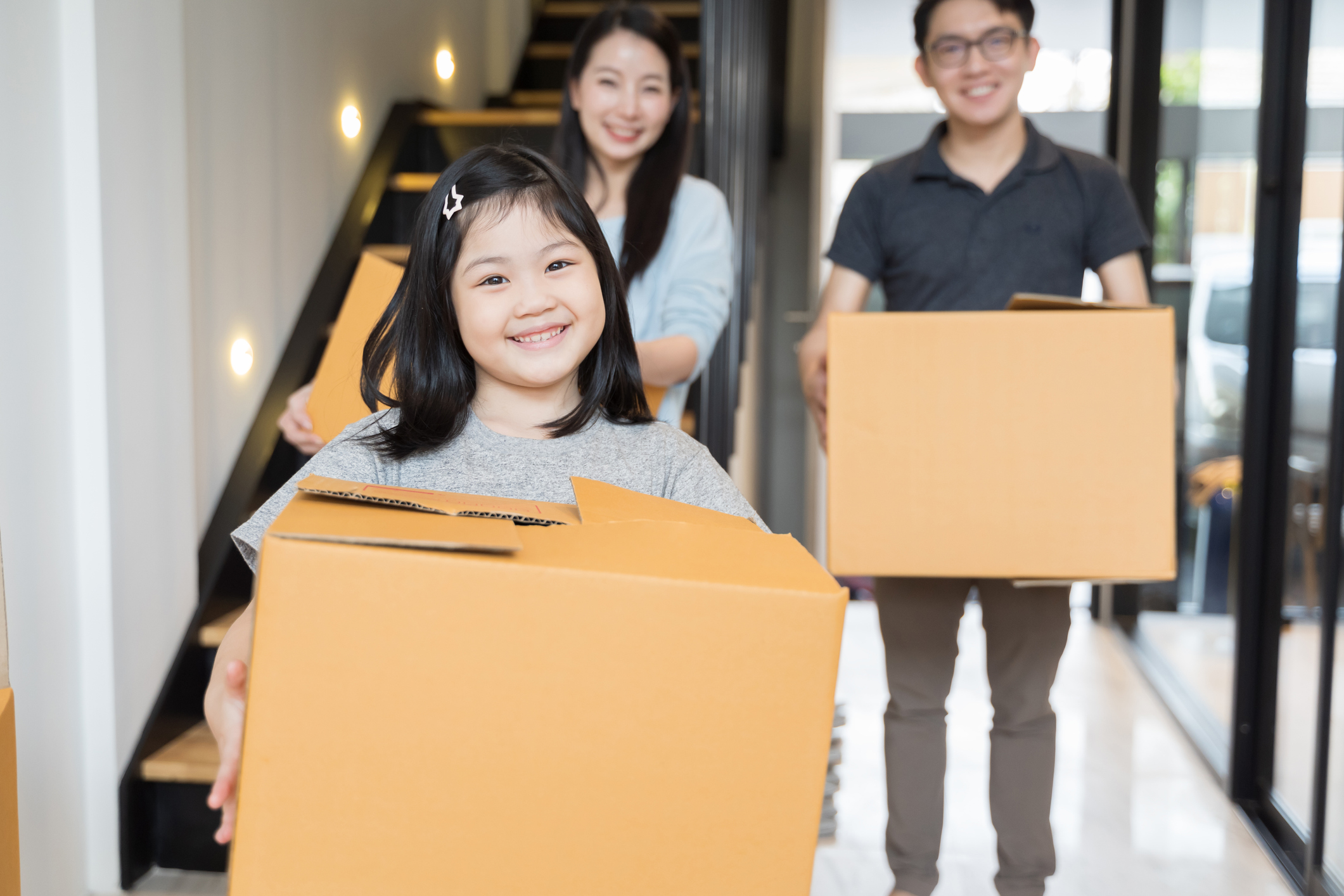Stock photo of a family moving boxes