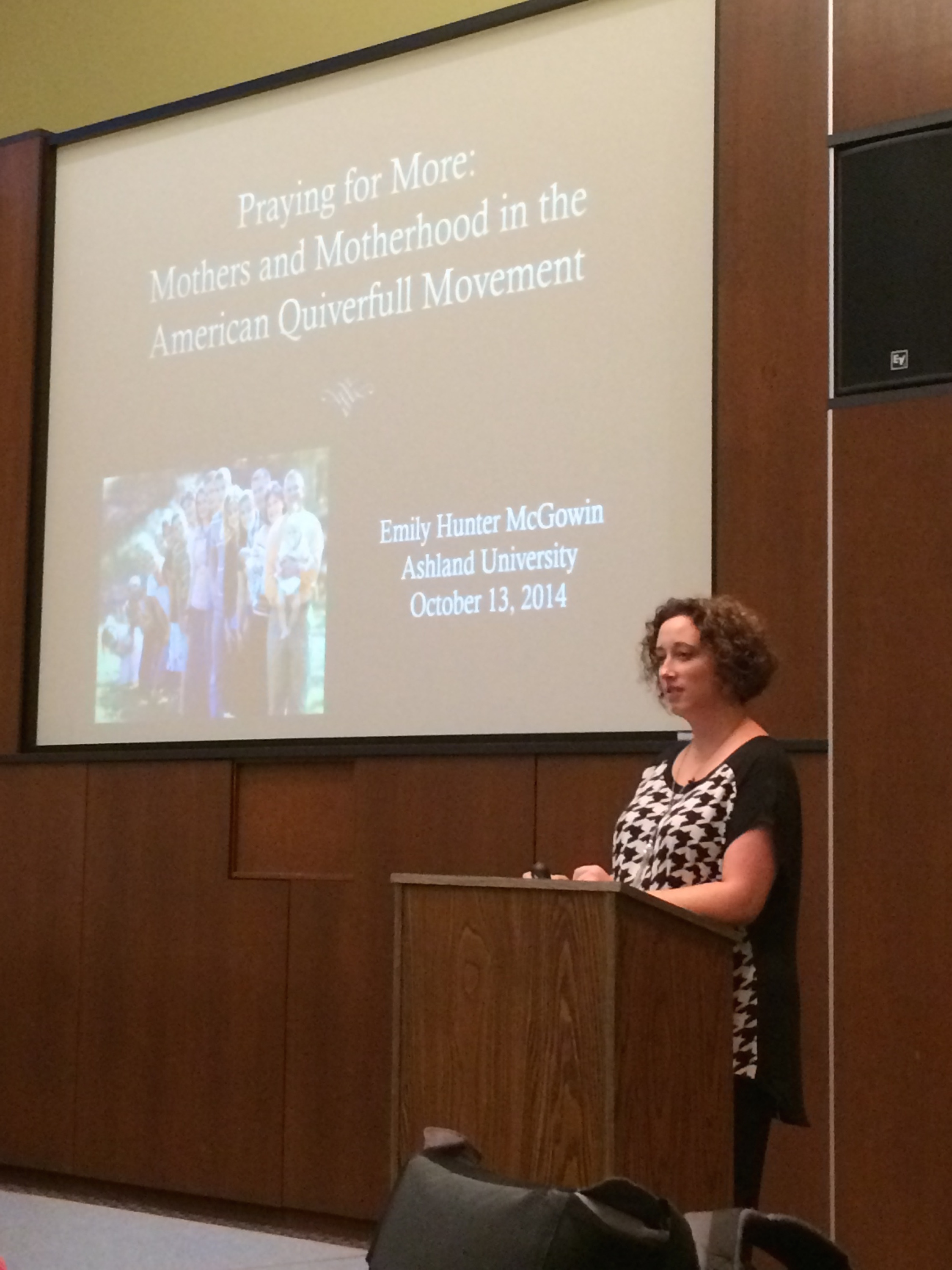 Emily at a speaking engagement on her research