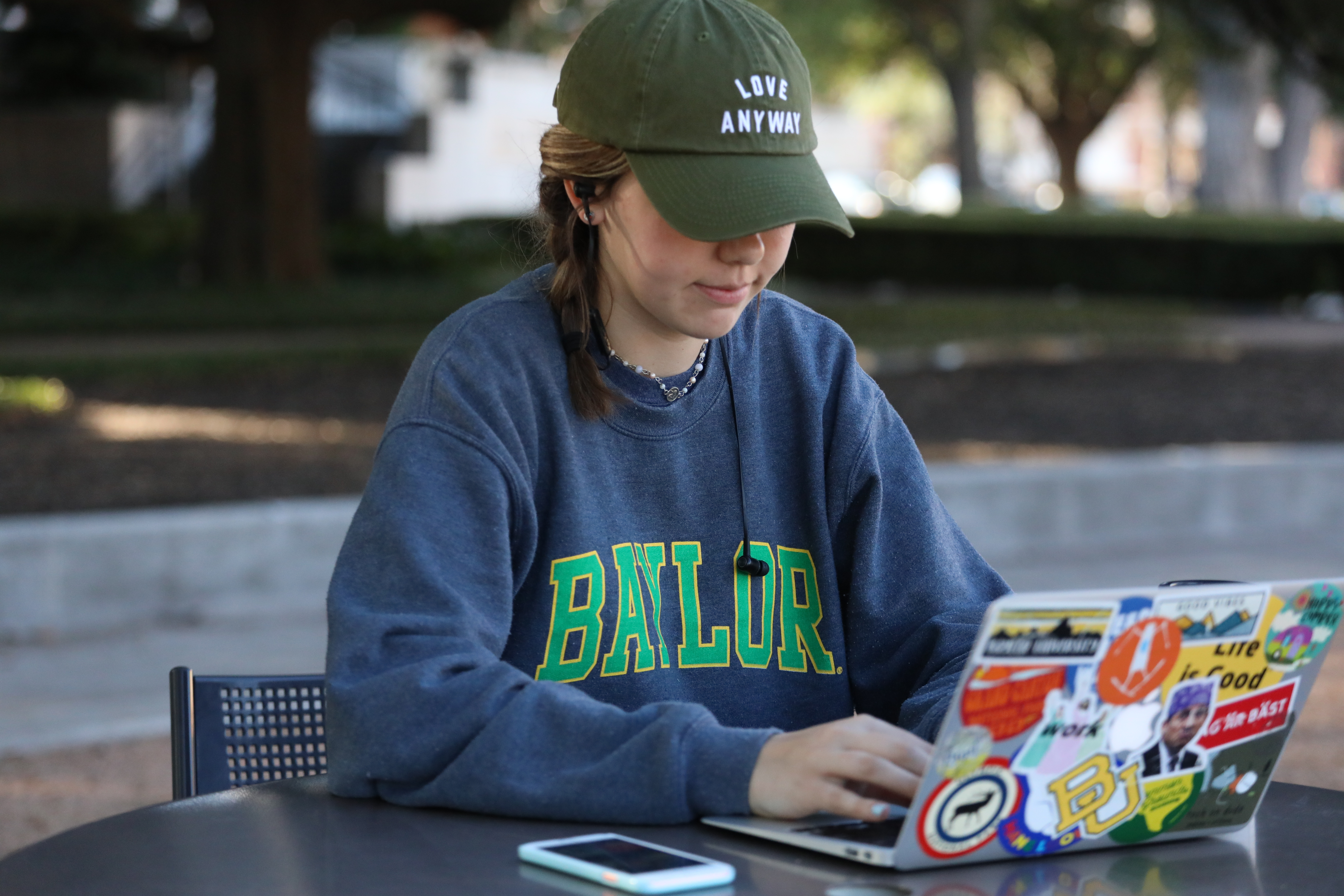 Woman on laptop outdoors