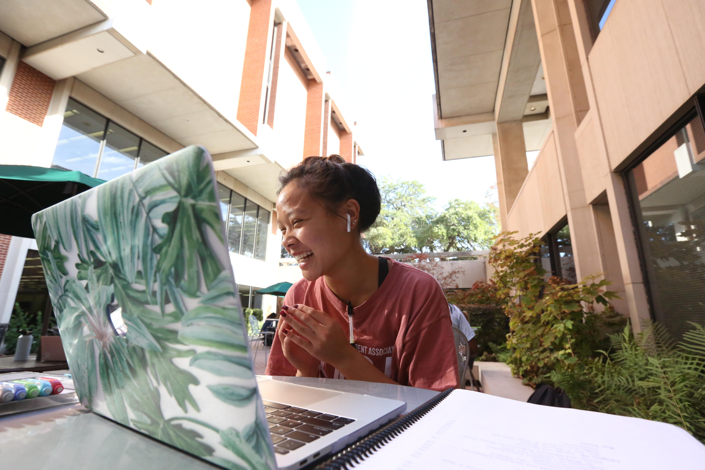 Woman enjoying studying outdoors