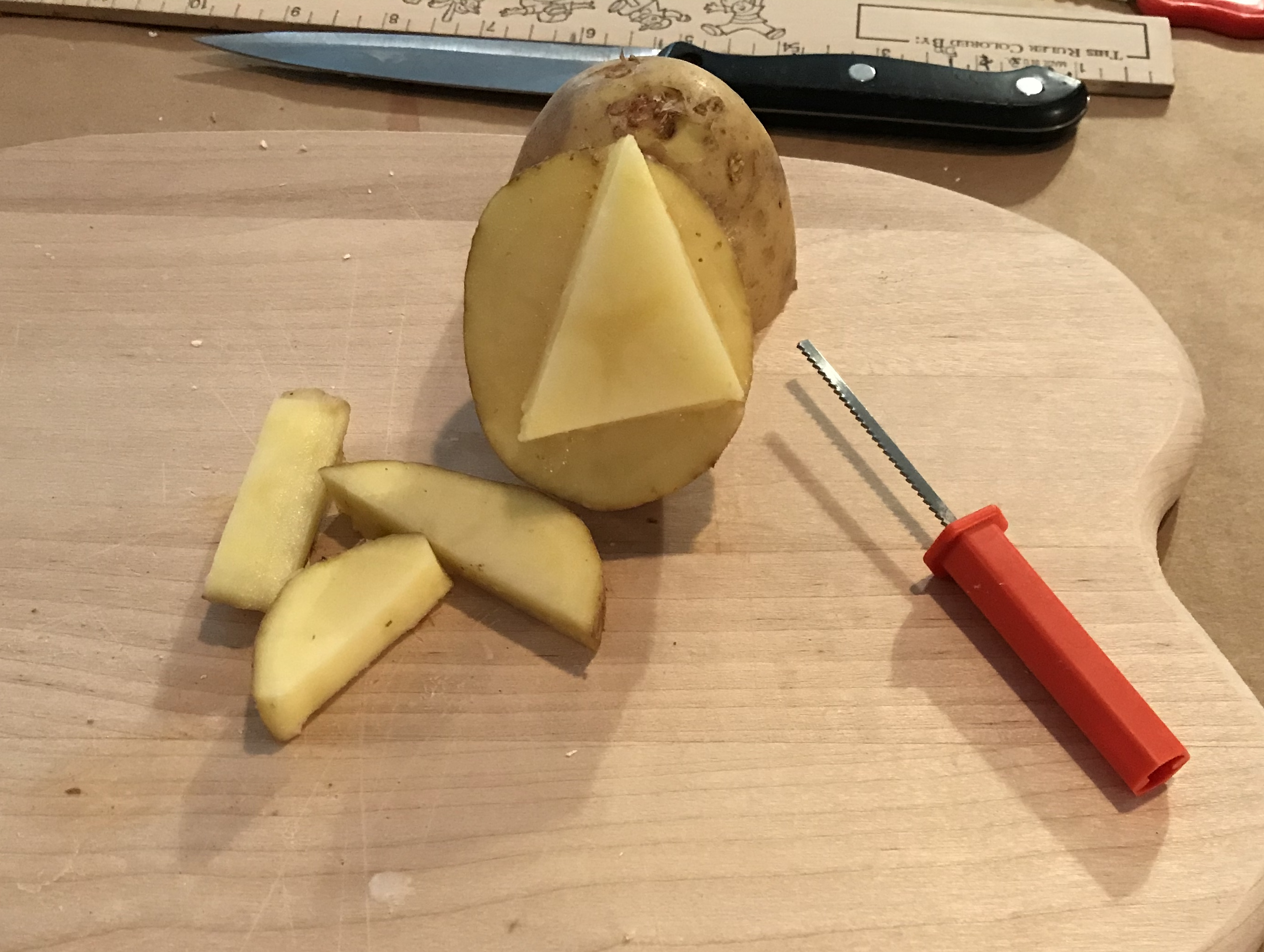 Cut out your shapes. Potato triangle.