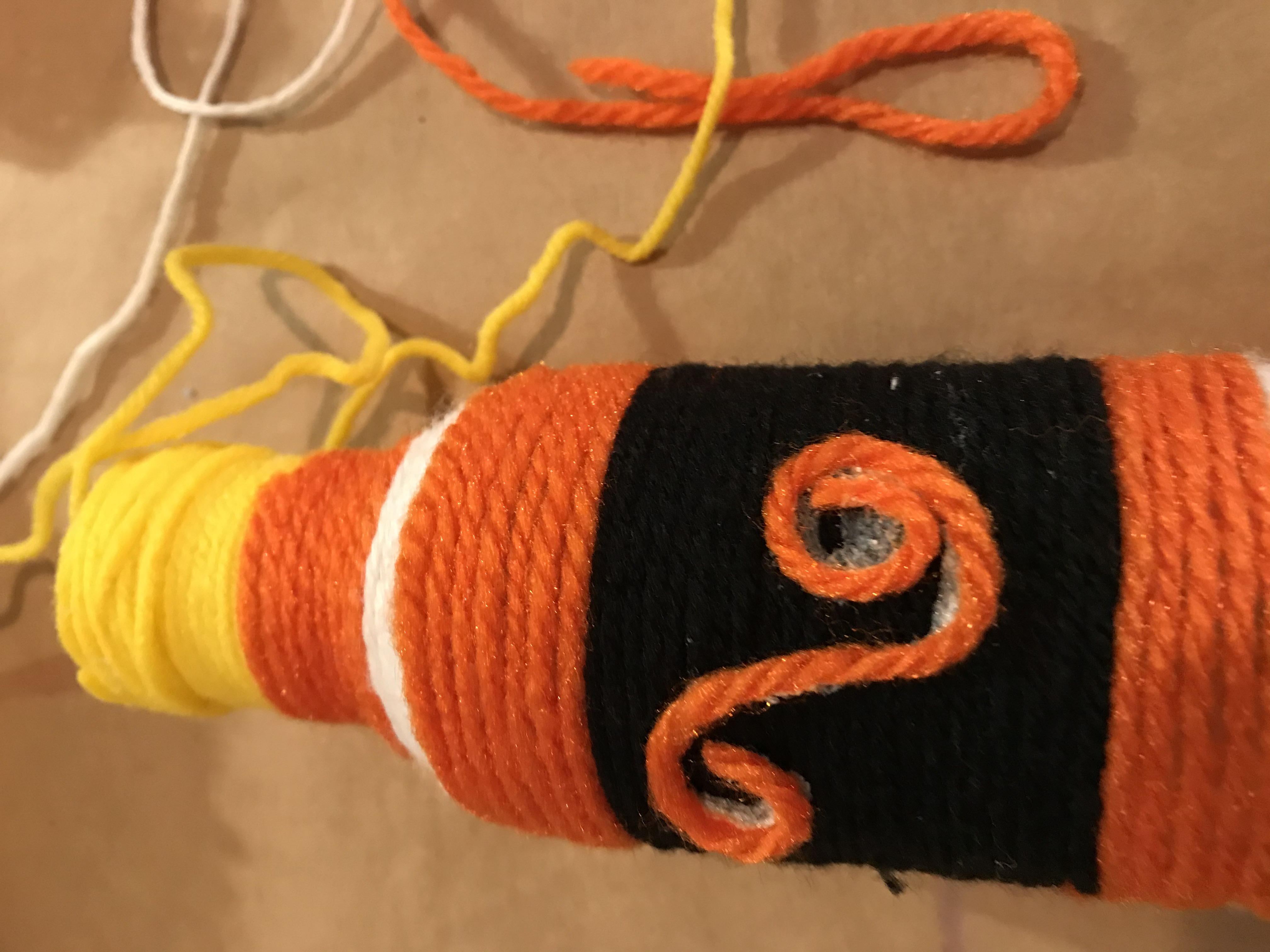 Or dip the yarn/string into a shallow bowl of glue and lay it down creating your design as you go.