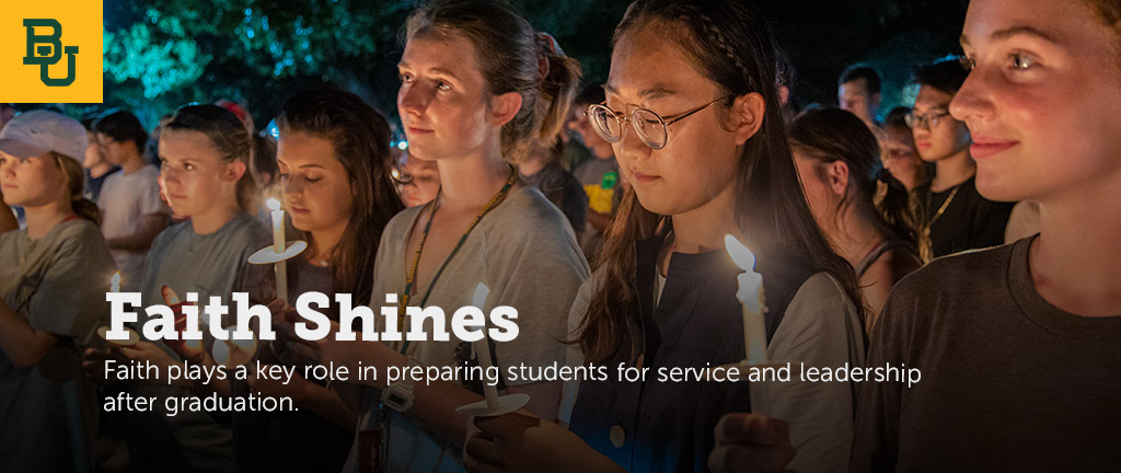 Students wwith candles during Welcome Week.