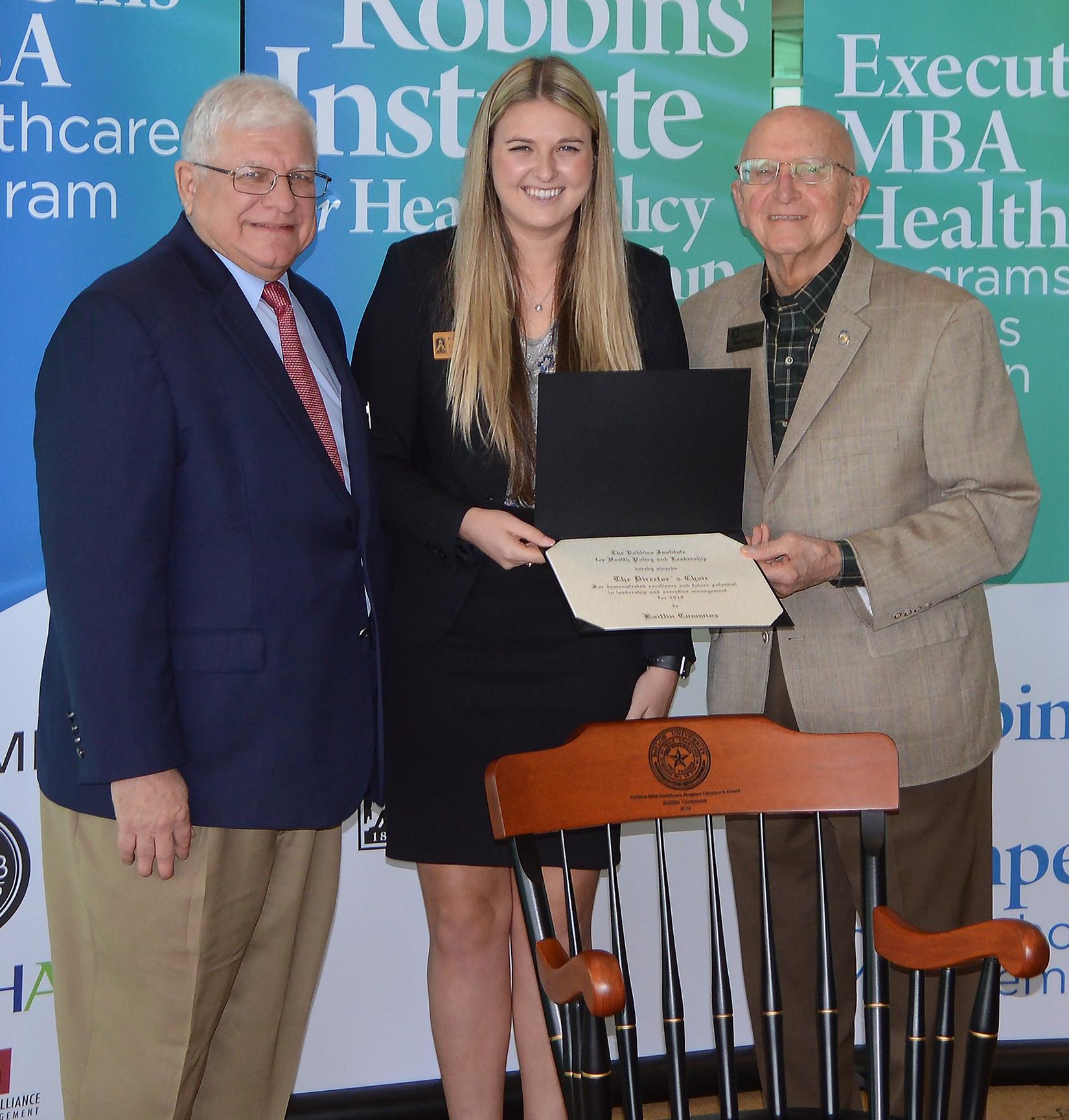 Photo of Katie Cummins accepting her award