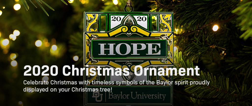 2020 Christmas ornament hanging on a Christmas tree.
