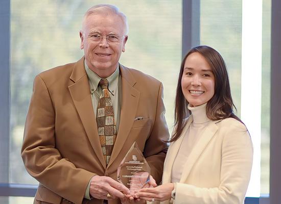 Photo of Cameron Thorson receiving the KPMG National Chairman's Award
