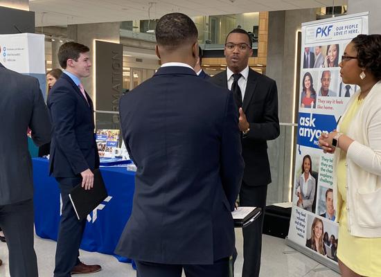 Students talking at a career fair booth