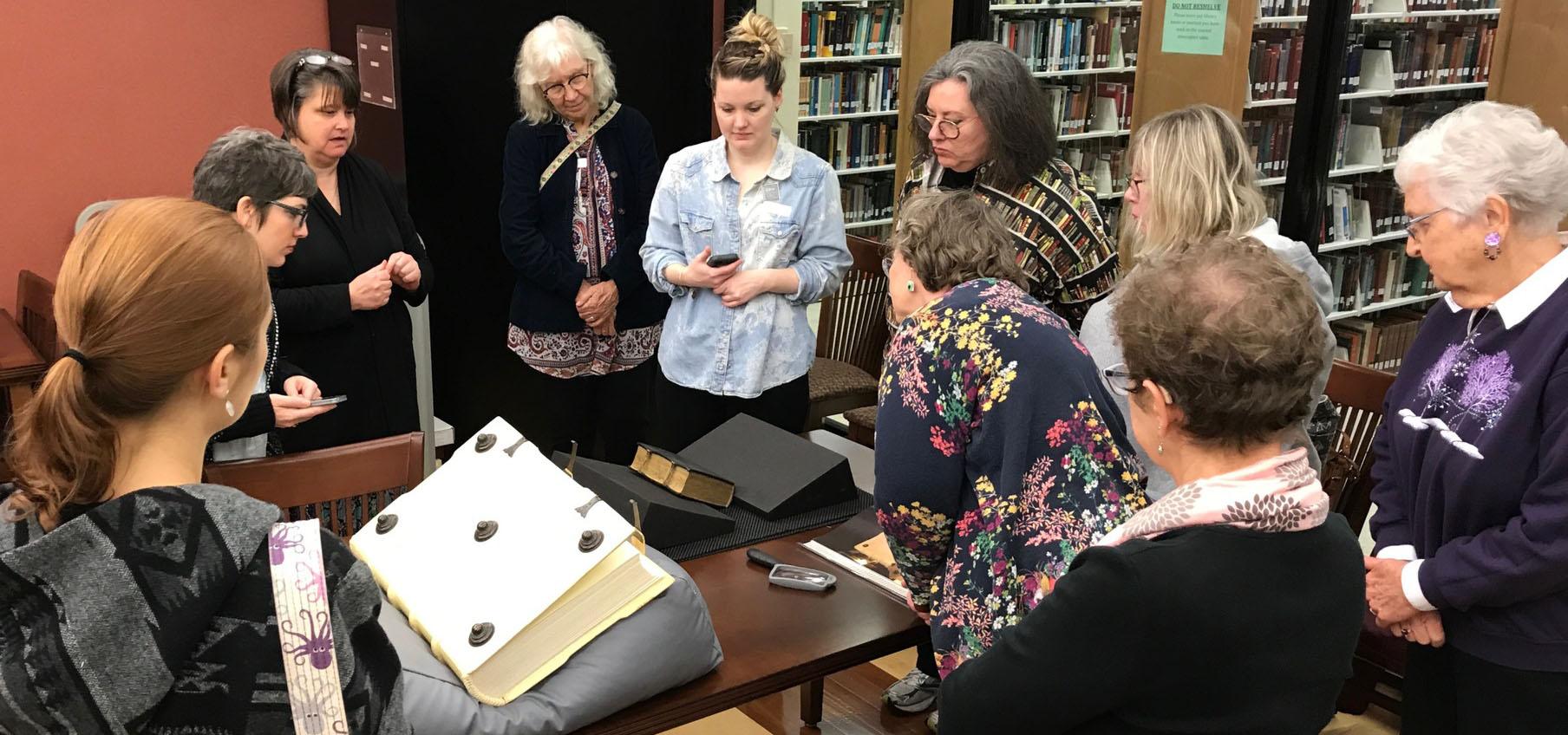 Teachers and Librarians gather around materials