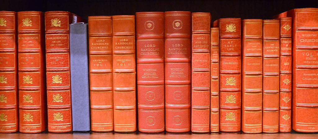 a row of red books on a shelf