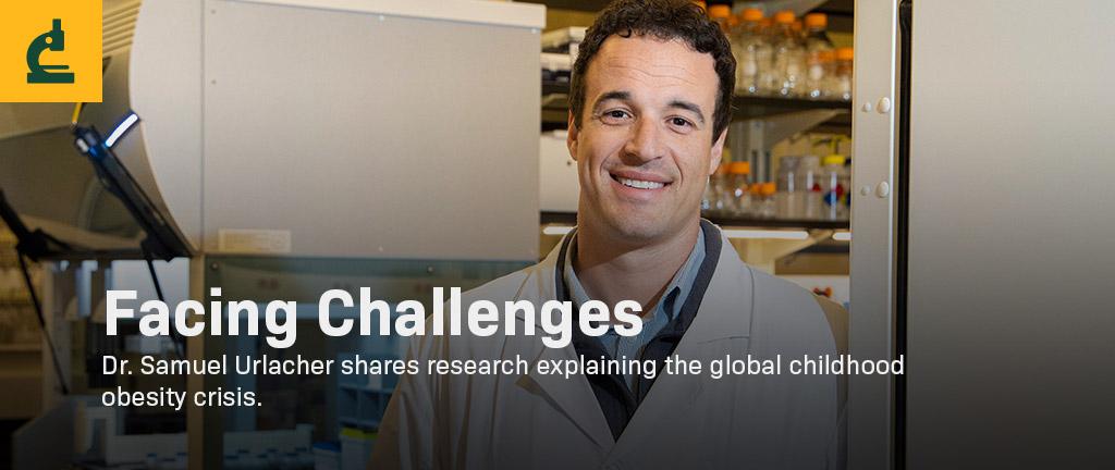 Dr. Samuel Urlacher standing in a lab.