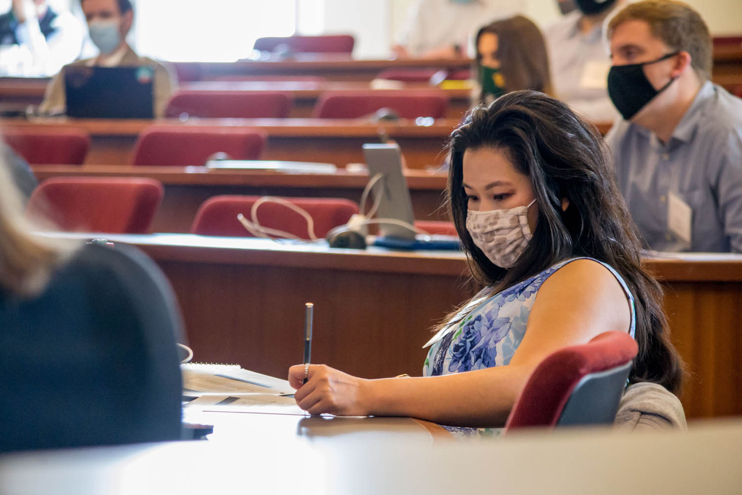 Student in mask is taking notes in Boot Camp