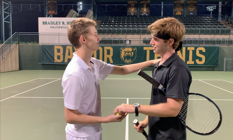 The tennis competitors greet one another after the match on the tennis court.
