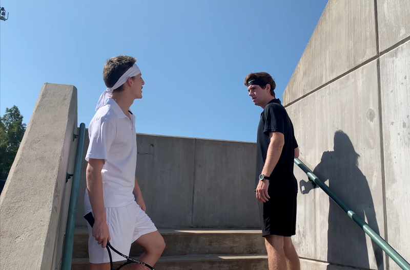 Two tennis competitor face off against one another on the stairwell at the tennis arena.