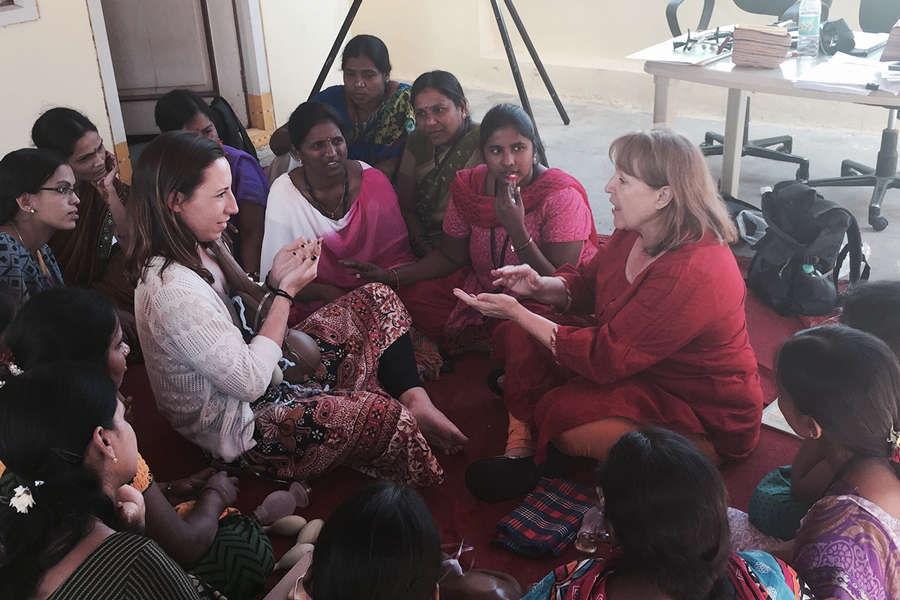 Baylor nursing faculty and students talk with a group of women on a mission trip to India.