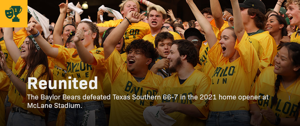 Students celebrating in the student section at McLane Stadium.