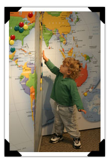 Child next to World Map